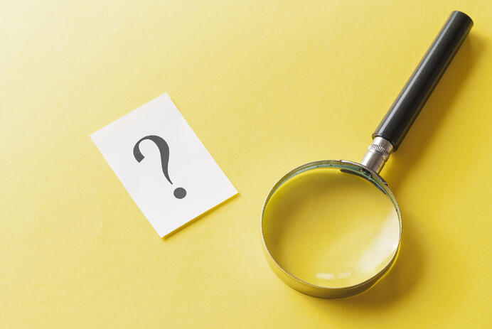 magnifying-glass-with-printed-question-mark-TNFRJXL